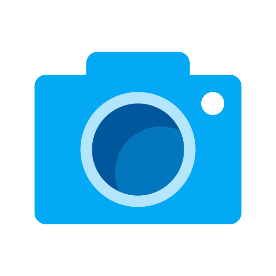 Google Images icon. It is a small camera symbol that is used for Google Images.  The object is square-shaped camera with a large round lens in the middle.   There is a little circle in the upper right hand of the object.