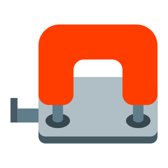 Dziurkacza icon. This icon represents hole punch. It is a square shape with rounded edges at the top. It has a small straight box with marks on the left side. Inside the square at the bottom is two round holes with two squares above them.
