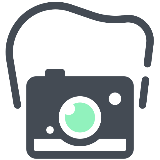 Kompaktowy aparat icon. The icon shows a hand-held picture camera with large round lens and a flash in the upper corner. The camera is rectangular with a raised portion above the lens where a viewing port would be.