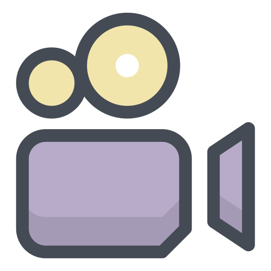 Film dokumentalny icon. The icon is for a documentary type film and has an old fashioned video camera with large rectangular base, protruding round lens, and two reels on the top represented by large circles.