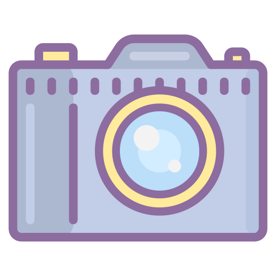 一眼レフカメラ icon. There is a square with curved edges. On the top of the square there are two areas that protrude. There is also a circle inside the square to depict a camera lens as well as a small dot in the upper right corner.