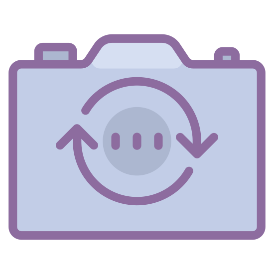 Trocar Câmara icon. The outer edge of the icon is in the shape of a hand-held camera that one would take pictures with. The shape is rectangular with a slight bump at the top, similar to a camera. Inside the rectangle are two arrows that form a circle with the arrows pointing in a clockwise direction.