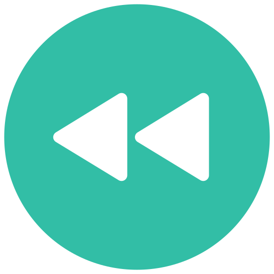 Rewind icon. The icon is a rewind or back symbol. It consists of two triangles pointing to the left or backwards. Both triangles touch each other, with the second triangle having its apex obscured or abutted into the first triangle.