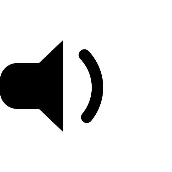 Niski poziom głośności icon. The icon looks like a triangle with curved edges laying vertical but the point facing left is missing. It is replaced with a smaller rectangle shape with curved edges. At the base of the vertical triangle which is facing left is a small backwards C shape at the center.