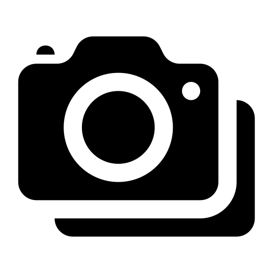 Cameras icon. This icon is two cameras, one below the other. The bottom camera is slightly to the right and overlaps the higher camera. Both cameras are exactly the same shape: rounded rectangles with a black dot on their top left, a rounded line is bulging from the upper line to the right, and there is a large open circle inside the camera centered to the right.
