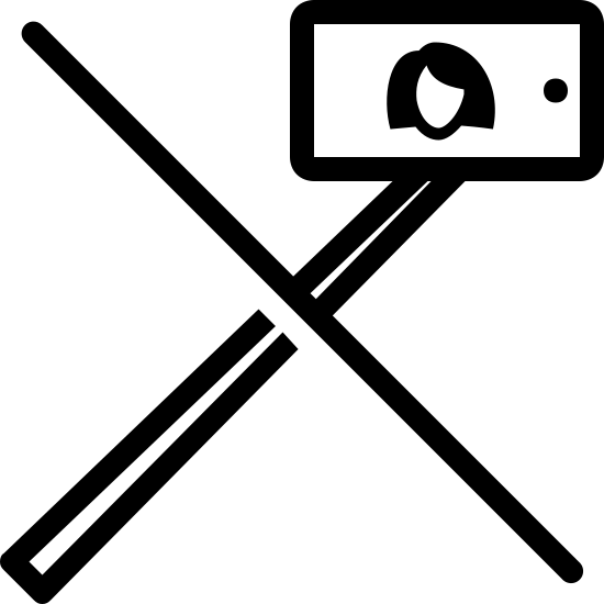 No Selfie Stick icon. It's a rectangular smart phone in horizontal orientation with a picture of a woman displayed on the screen.  Attached to the smart phone is a long stick coming out the bottom.   The entire image has a angular strike-through going through it to indicate that selfie sticks are not allowed.