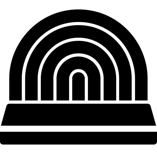 Stage Filled icon. This shape has a rectangle on the bottom which is split into two horizontally. The bottom is slimmer than the top. On top of it are 4 curved lines starting from the right and ending on the left of the rectangle like a rainbow.