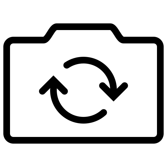 Switch Camera icon. The outer edge of the icon is in the shape of a hand-held camera that one would take pictures with. The shape is rectangular with a slight bump at the top, similar to a camera. Inside the rectangle are two arrows that form a circle with the arrows pointing in a clockwise direction.