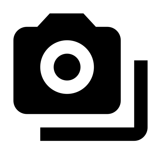 Wiele kamer icon. This icon is two cameras, one below the other. The bottom camera is slightly to the right and overlaps the higher camera. Both cameras are exactly the same shape: rounded rectangles with a black dot on their top left, a rounded line is bulging from the upper line to the right, and there is a large open circle inside the camera centered to the right.