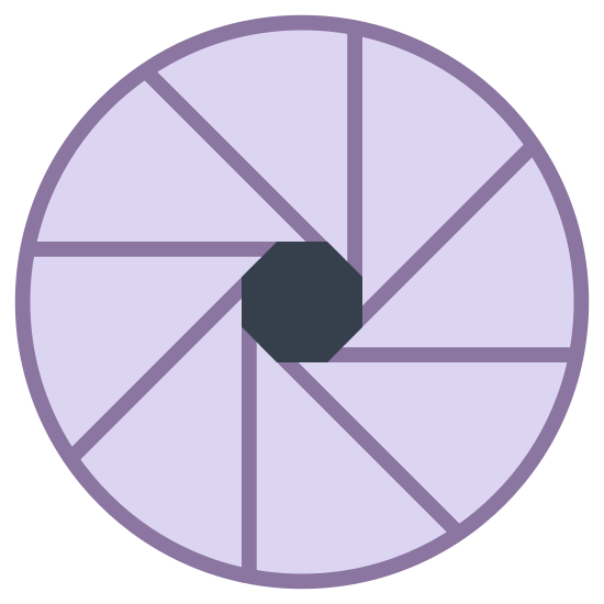 Aperture icon. This is a picture of a circle with blades going around the center of it. they are going in a counter-clockwise direction, and there are eight blades in total