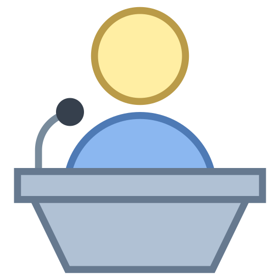 Lecturer icon. The icon shows a man standing at a podium. The podium has a tall rectangular base, and a flat table at the top. There is a speaker on top of the podium.