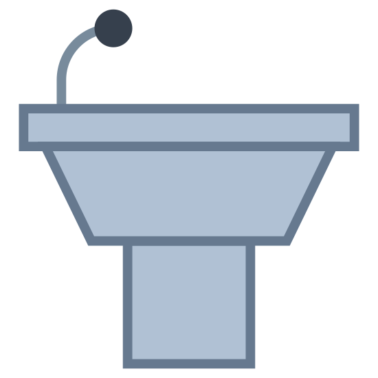 Pódio sem locutor icon. This icon represents a podium without a speaker. It is a half square with a top flat rounded rectangle. On the left hand side a small line leads up to a small circle representing a microphone.