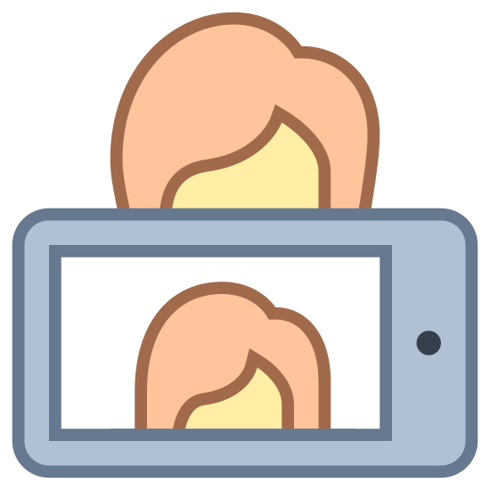 Selfie icon. It's and image of a woman with a cell phone in front of her. On the screen on the phone is a selfie picture of the woman. It looks like she just took the picture.