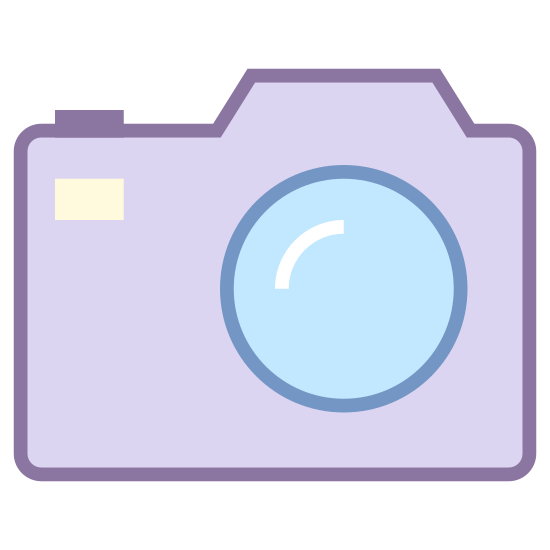 Câmera SLR icon. There is a square with curved edges. On the top of the square there are two areas that protrude. There is also a circle inside the square to depict a camera lens as well as a small dot in the upper right corner.