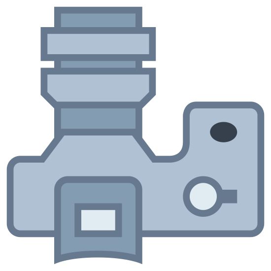 SLR Large Lens icon. It's a logo for an SLR large lens and has a top-down picture of a camera with a large lens. There is a shutter button of the right side of the camera and a large lens made up of rectangles coming out of the top of the image.