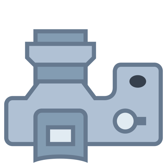 SLR Small Lens icon. It's a logo for an SLR small lens on a camera. The picture is a top-down view of a camera with a shutter button on the right and the lens predominantly displayed on the top of the picture.