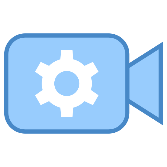 Automatyka aparatu icon. This is an image of a camera facing towards the right.  The camera is made up of a square with a trapezoidal lens.  Inside the square is a six teethed gear wheel with a circle inside of it.