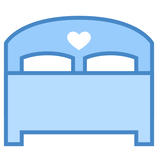 Double Bed icon. This is an image of a double bed.  The outline of the bed is drawn.   The bed has enough room for two people and has two pillows along with a hear-shaped engraving on the head board.