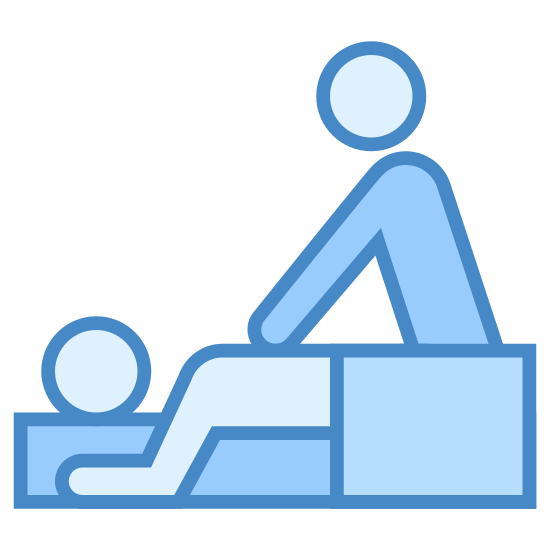 Massage icon. There are two people in the image. One person is laying down on his stomach with a blanket covering his lower half. The other person is standing above the person laying down and giving him a shoulder massage.