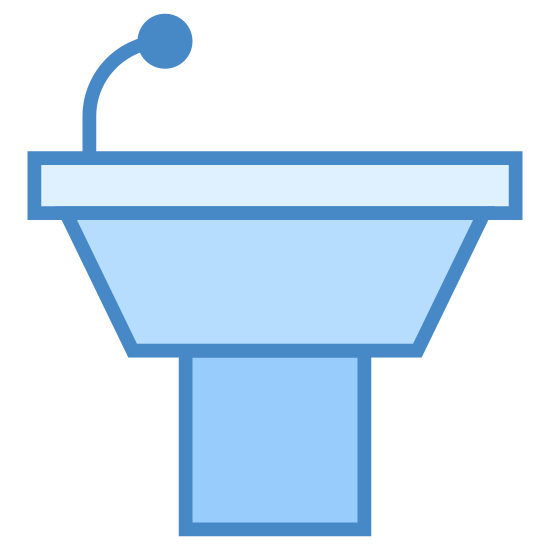 Podium icon. This icon represents a podium without a speaker. It is a half square with a top flat rounded rectangle. On the left hand side a small line leads up to a small circle representing a microphone.