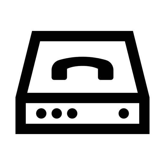 Bramka VoIP icon. It's a graphic of a router laying sideways with a picture of a phone on top of it. It has four dots on it's front face. Three of them are grouped to the left and the other is on the right. It has a symbolic wired connection coming out from underneath it.