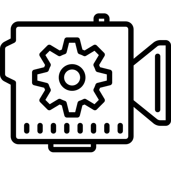 Câmera automática icon. This is an image of a camera facing towards the right.  The camera is made up of a square with a trapezoidal lens.  Inside the square is a six teethed gear wheel with a circle inside of it.